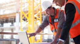 Construction Workers on Laptop